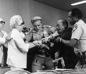 Lillian Baker - Lillian Baker (Left) tries to grab Nisei veteran Jim Kawaminami's (Right) testimony from his hands during the Los Angeles hearings of the Commission on Wartime Relocation and Internment of Civilians in August 1981.