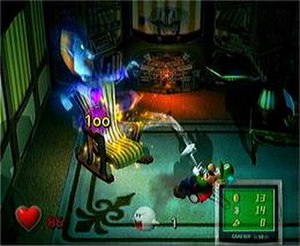 Luigi's Mansion - Luigi capturing one of the game's unique ghosts using the Poltergust 3000. The number represents the ghost's HP, which must be reduced to zero in order for Luigi to capture it.