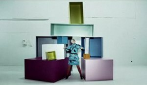 "Handle Me - Robyn standing in front of colored boxes in the second music video for ""Handle Me"""