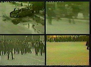 Nagorno-Karabakh War - Television images showing burnt automobiles and marauding rioters on the streets of the industrial city of Sumgait during the pogrom there in February 1988.