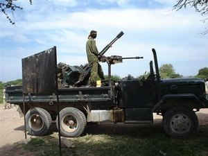 Battle of Jowhar - Image: Transitional Federal Government soldier (Somalia) on a technical at the Battle of Jowhar