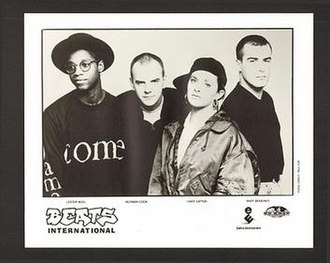 Beats International - Beats International, 1990.  From L to R: Lester Noel, Norman Cook, Lindy Layton, Andy Boucher
