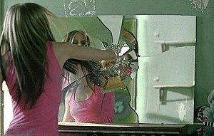 Don't Tell Me (Avril Lavigne song) - Lavigne breaks a mirror with her hands to vent her anger.