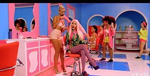 The Boys (Nicki Minaj and Cassie song) - Minaj in a colorful salon wearing a pink wig.
