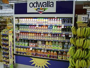 Odwalla - A refrigerated Odwalla display case at a grocery store; Odwalla uses these cases to increase its products' visibility.