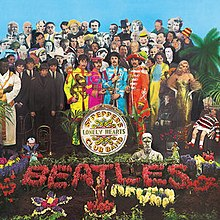 "A colour image of the Beatles, holding marching band instruments and wearing colourful uniforms, stand near a grave covered with flowers that spell ""Beatles"". Standing behind the band are several dozen famous people."