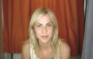 Single (Natasha Bedingfield song) - The music video features four sequences. In one, Bedingfield stops at a photo booth to take her picture.