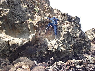 Suzaki Imperial Villa - A police officer climbing the rocks near Tenno Beach.