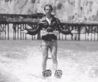 Fonzie preparing to jump over a shark while on water skis, in a scene in Happy Days.