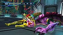 A person in a powered armor grabs a chameleon-like creature. Atop the screen are 2D icons which indicates the health and ammo of the player.