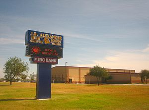 John B. Alexander High School - J. B. Alexander High School sign and gymnasium in the background