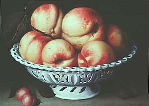 Fede Galizia - Peaches in a pierced white faience basket (1578-1630).