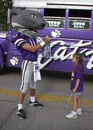 Willie the Wildcat (Kansas State) - Willie the Wildcat impresses a young Wildcat fan