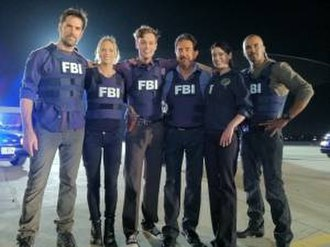 Criminal Minds - Cast members in 2011–12: (left to right) Gibson, Cook, Gubler, Mantegna, Brewster and Moore. Absent: Kirsten Vangsness