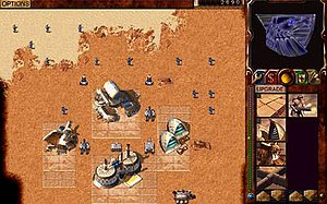 Dune 2000 - In-game screenshot; the player's base with units is visible.
