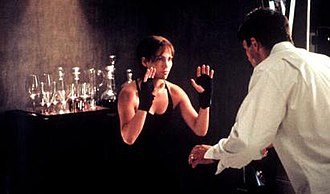 Enough (film) - An image from the film, depicting Slim (left) beating her abusive husband Mitch (right). This ending sequence received widespread praise.
