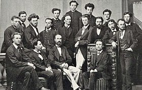 A group of 18 men in 19th century dress