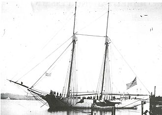 """Battle of Forts Jackson and St. Philip - One of the """"bummers"""", as they were known in the Union Navy. Mortar Schooner of Porter's Bombardment fleet, New Orleans, 1862. A crewman between the masts is leaning on the muzzle of the 13-inch seacoast mortar.(Peabody Museum of Salem)"""