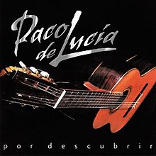 A flamenco guitar is depicted against a black background.