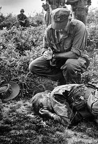 Dickey Chapelle - Henri Huet's photograph of Chapelle receiving the last rites in Vietnam.