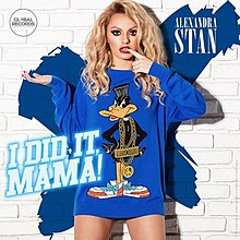 Alexandra Stan posing knowless sporting a blue duck-designed T-shirt