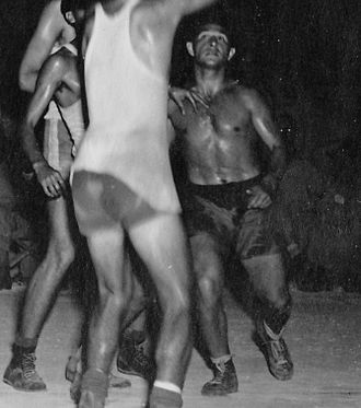 Biak - Basketball player Mel Hirsch during WWII playing on the U.S. Army Air Corps 13th Troop Carrier Squadron's officers team against the enlisted men for the 403rd Group Championship, on Biak Island, April 9, 1945.
