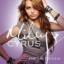"A teenage girl with long, curly brunette hair and a gray T-shirt faces the font as she touches her head with her right hand and waist with her left. Letters in the center of the image overlapping the girl's chest spell ""Miley Cyrus"" in cursive while ""Party in the U.S.A."" is spelled in print in the bottom right corner. The image has a lavender background."