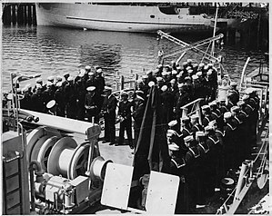 USS Shelter (AM-301) - Image: USS Shelter Crew Assembled for Commissioning