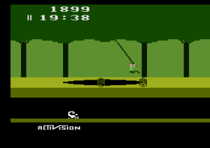 Pitfall! - Screenshot of Pitfall Harry swinging on a vine over a pit in the Atari 2600 version of the game.
