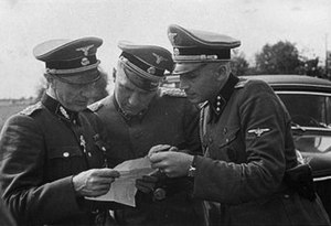 Richard Baer - Auschwitz commandant Richard Baer in the centre, with Lolling and Höcker (right).