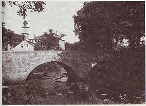Branch River (Rhode Island) - 1921 photo of the Stone Arch Bridge over the Branch River and Slater mills in Slatersville, Rhode Island