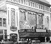 "Tall building with a marquee featuring production of ""Dance of Life""."