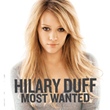 "The portrait of a blonde woman sitting in front of a white background. She is sitting, looking into the camera. She is wearing a gray colored, full-sleeved top. To the bottom of the picture, the words ""Hilary Duff"" and ""Most Wanted"" are printed in grey block letters."
