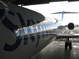 Fokker 100 - Skywest Airlines Fokker 100 side view, during maintenance at Perth Airport