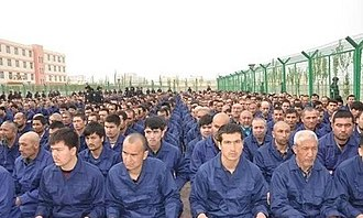 Xinjiang re-education camps - Detainees listening to speeches in a re-education camp in Lop County, Xinjiang, April 2017.