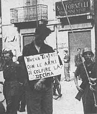 "Italian partisan hung by Fascists of the Decima Flottiglia MAS.  The sign says ""He attempted to shoot the Decima""."