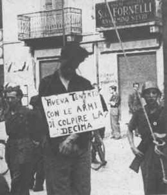 "Italian Civil War - Italian Civil War scene. Partisan hanged by republican fascists of the Decima Flottiglia MAS.  The sign says ""He attempted with weapons to shoot the Decima""."