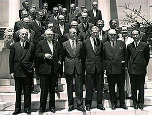 Konstantinos Karamanlis - Konstantinos Karamanlis, his cabinet with Deputy Prime Minister Panagiotis Kanellopoulos (front left) and German Vice-Chancellor Ludwig Erhard with a German/European delegation during a visit by Erhard to sign the protocols of Greece's Treaty of Association with the European Economic Community (EEC) in 1961. Paul-Henri Spaak is second from the right (front row).
