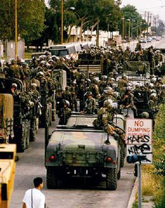 1992 Los Angeles riots - Marines disembark in Compton from their Humvees and trucks on May 2, 1992