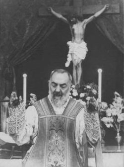 Padre Pio during the celebration of Mass. His Mass would often last hours, as the mystic received visions and experienced sufferings. Note the coverings worn on his hands to cover his stigmata.