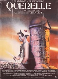 Querelle A Man In A Sailor Uniform Leads With His Back On A Large Brick Phallus Sculpture