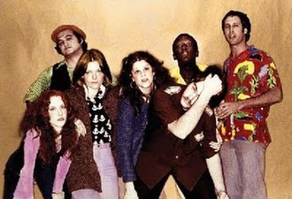 Saturday Night Live - The original 1975 cast, from left to right: Laraine Newman, John Belushi, Jane Curtin, Gilda Radner, Dan Aykroyd, Garrett Morris, and Chevy Chase