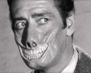Mr. Sardonicus - Guy Rolfe displays the torturous make-up used to transform him into Mr. Sardonicus.