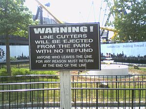 Six Flags Great Adventure - A sign warning people not to cut lines