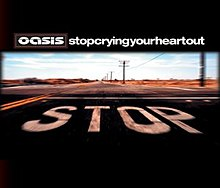 "Picture of a desertic road. In the pavement the word ""Stop"" is painted in capital white letters. Above it, Oasis's stylised logo and ""Stop Crying Your Heart Out"", written in lowercase white letters and without spaces, appear."