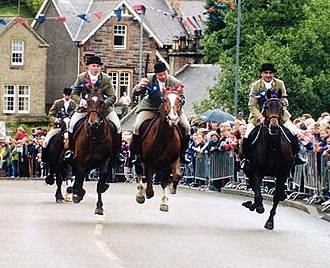 Common Riding - Riders returning from riding the Selkirk Marches gallop in at The Toll