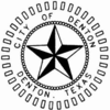 "A 3-d black and white star with. The words ""City of Denton Denton, Texas"" encircle the star."