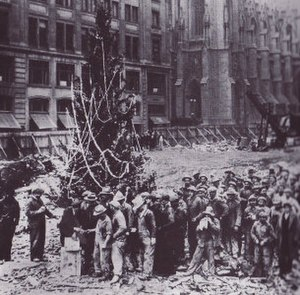 Rockefeller Center Christmas Tree - The first tree at Rockefeller Center, erected by construction workers in 1931 shortly after the site was cleared. Above, the workers line up for pay beside the tree, adorned with garlands made by workers' families.