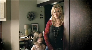 "Because of You (Kelly Clarkson song) - Clarkson and her younger self (Kennedy Nöel) in the music video of ""Because of You."""
