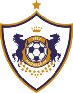 Shield-shaped football-club logo of a football surrounded by two rearing horses
